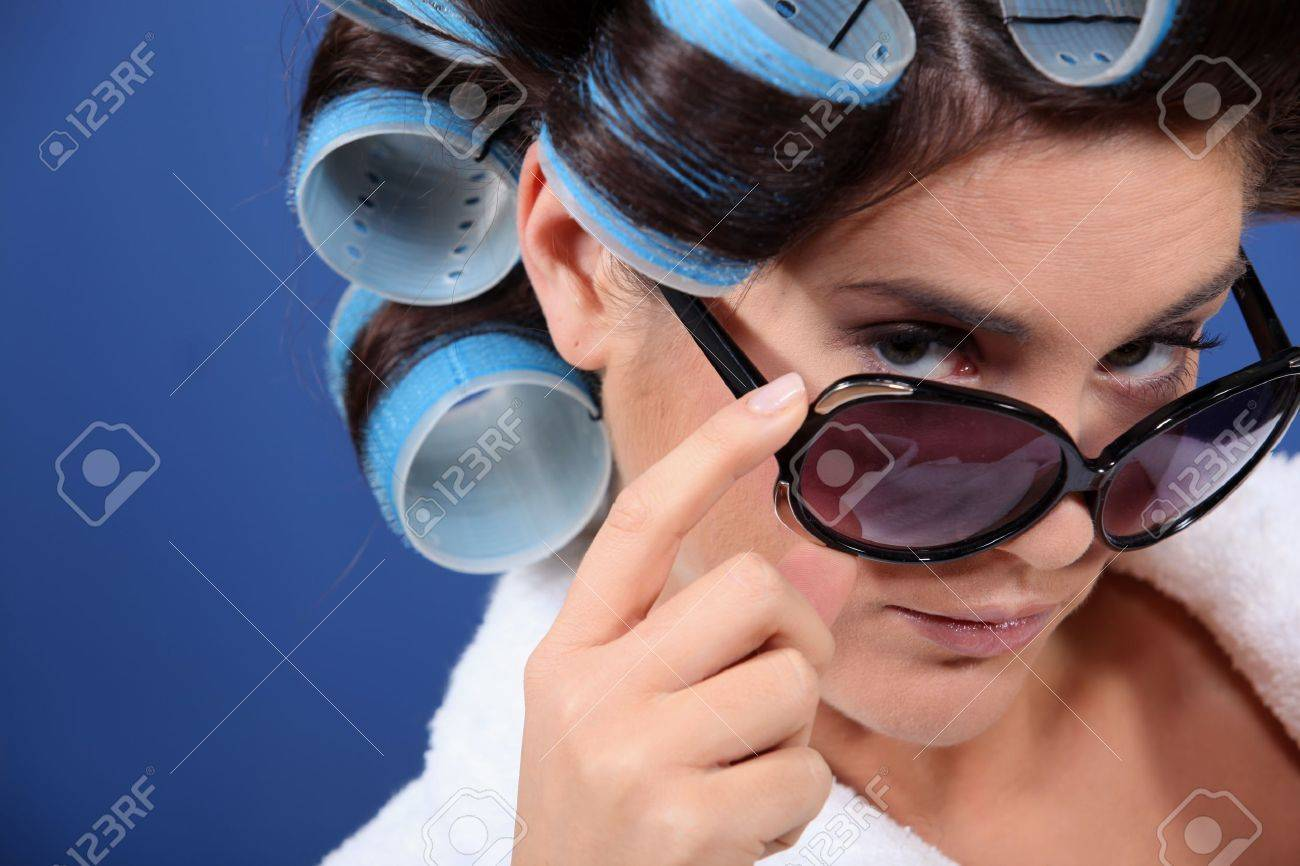 young woman with curlers in her hair Stock Photo - 10746813