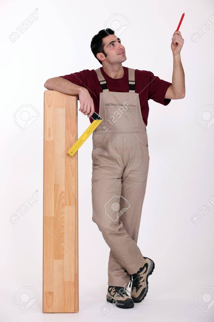 portrait of carpenter with parquet looking upwards Stock Photo - 10783270