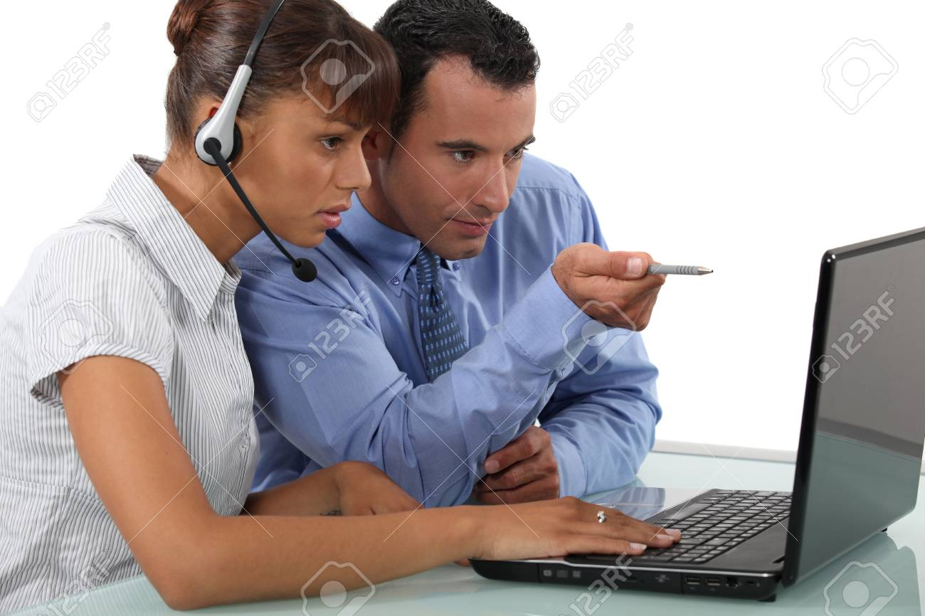 two office colleagues looking at a laptop Stock Photo - 10783529