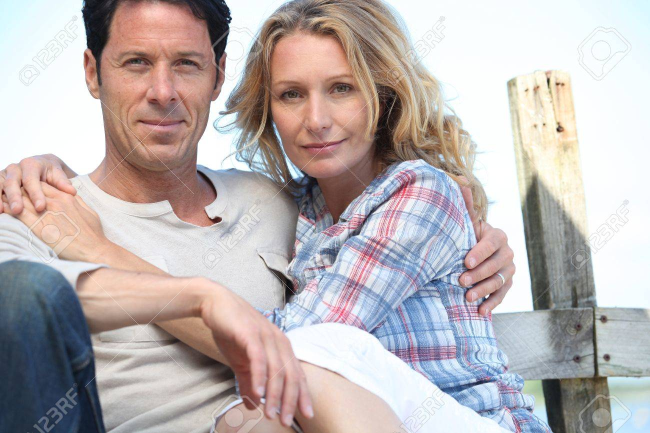 Relaxed mature couple sitting in the sunshine Stock Photo - 10783656