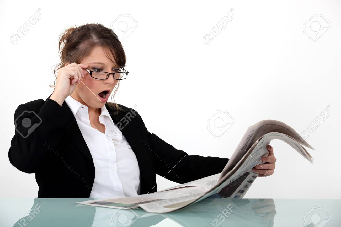 Businesswoman shocked at her newspaper Stock Photo - 10782524