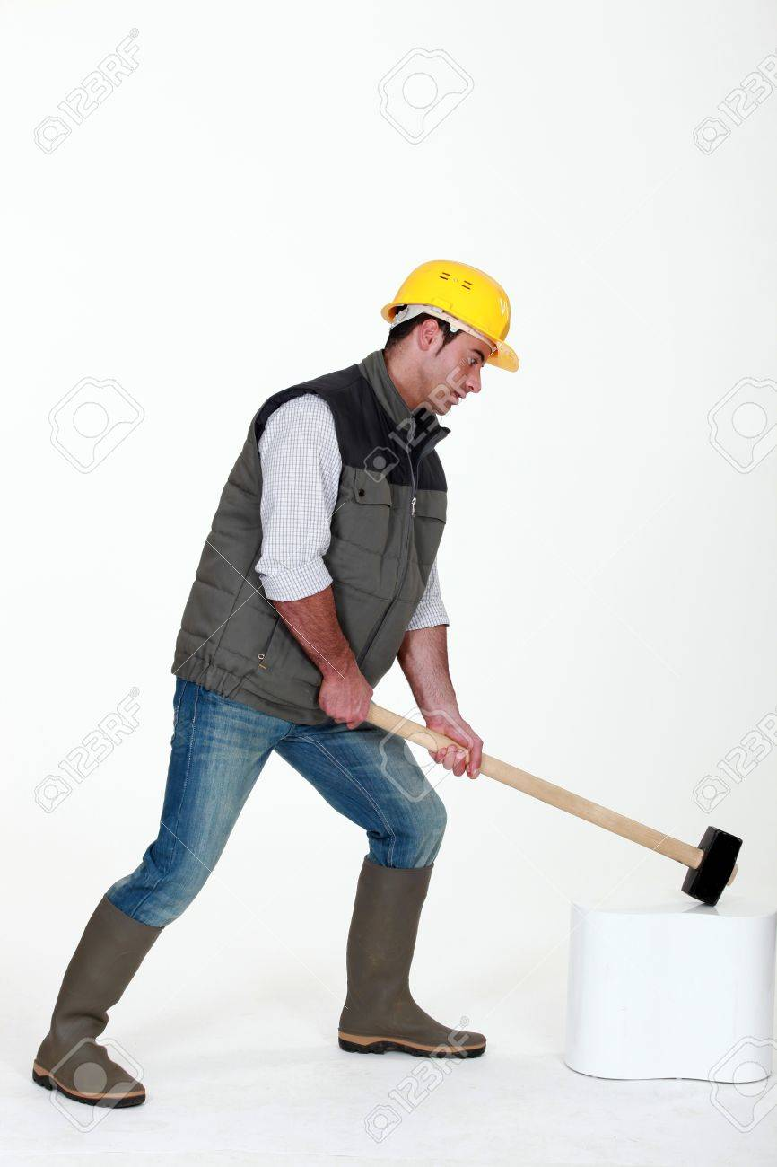 Man using hammer Stock Photo - 10783502