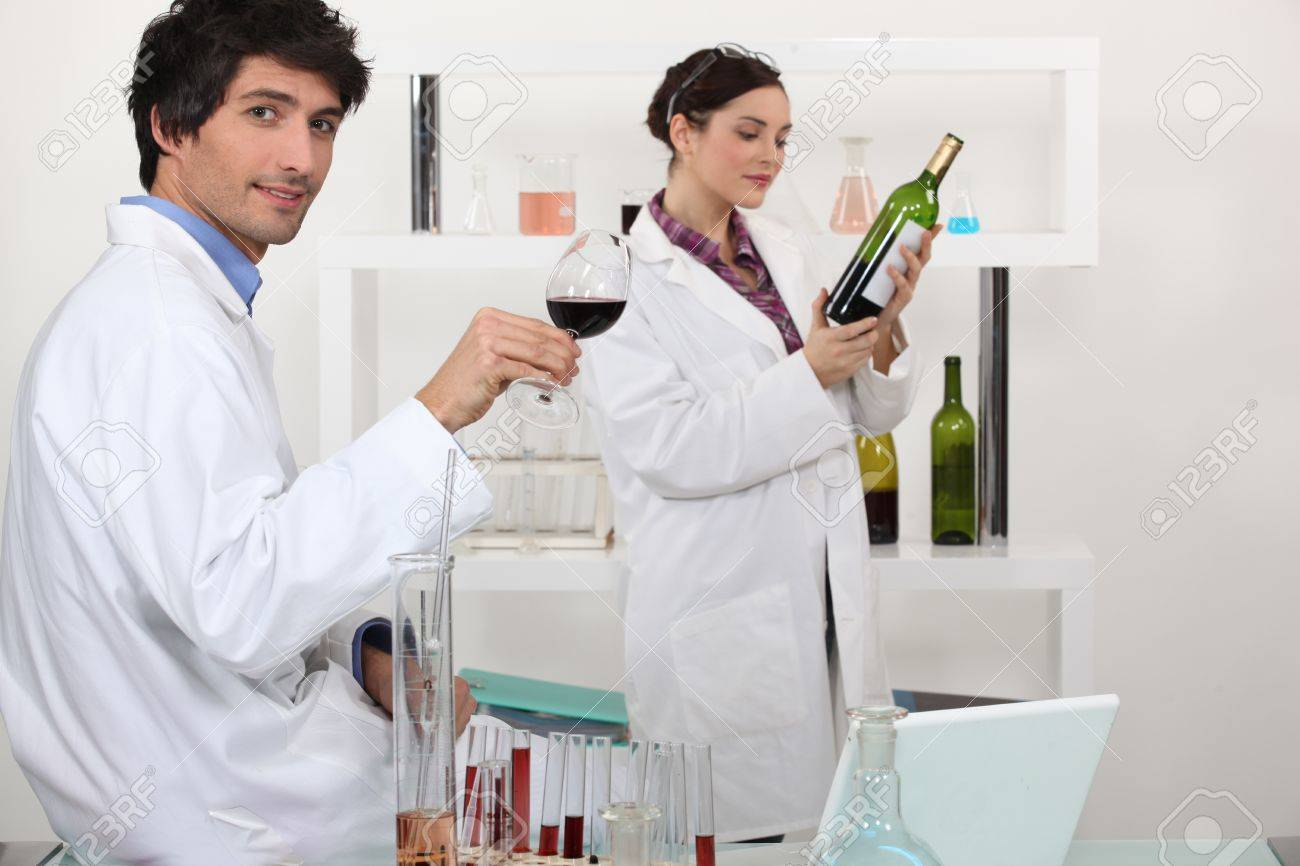 Man and woman testing wine in science laboratory Stock Photo - 10782692