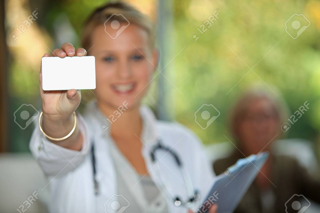 Doctor showing business card Stock Photo - 10782620