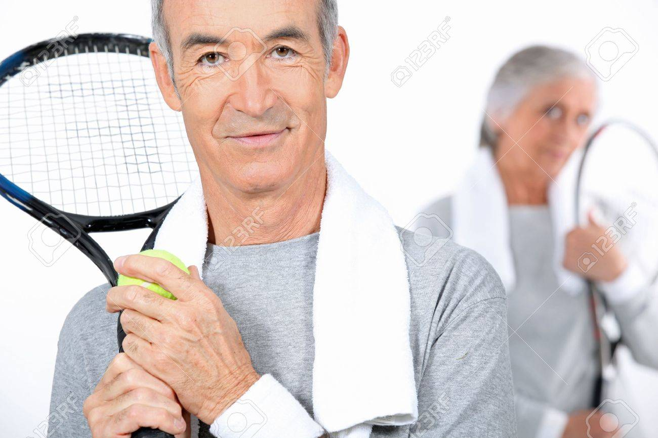 Elderly couple playing tennis together Stock Photo - 10782363