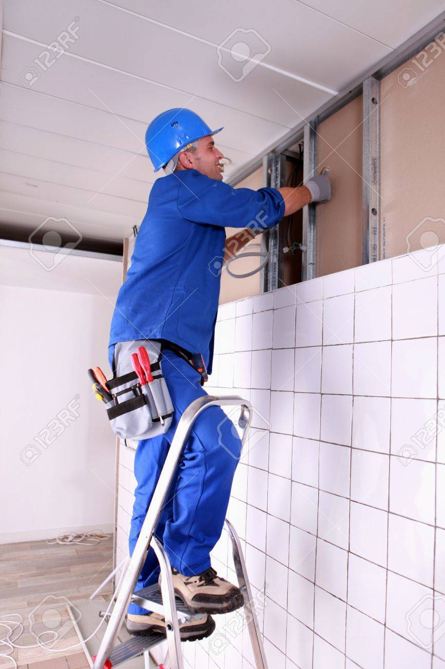 Construction worker panelling wall Stock Photo - 10852984