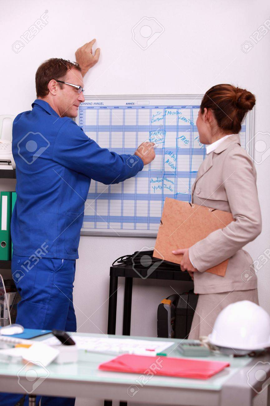 Construction foreman arranging a meeting with an engineer Stock Photo - 10853627