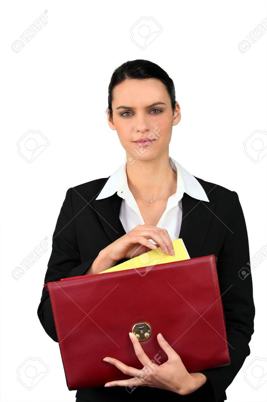 Smart woman taking a file out of a red briefcase Stock Photo - 10852287