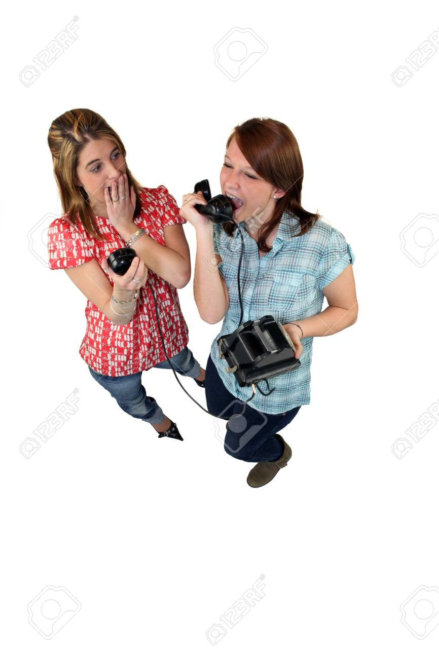 Girl screaming down an old fashioned phone Stock Photo - 10852136