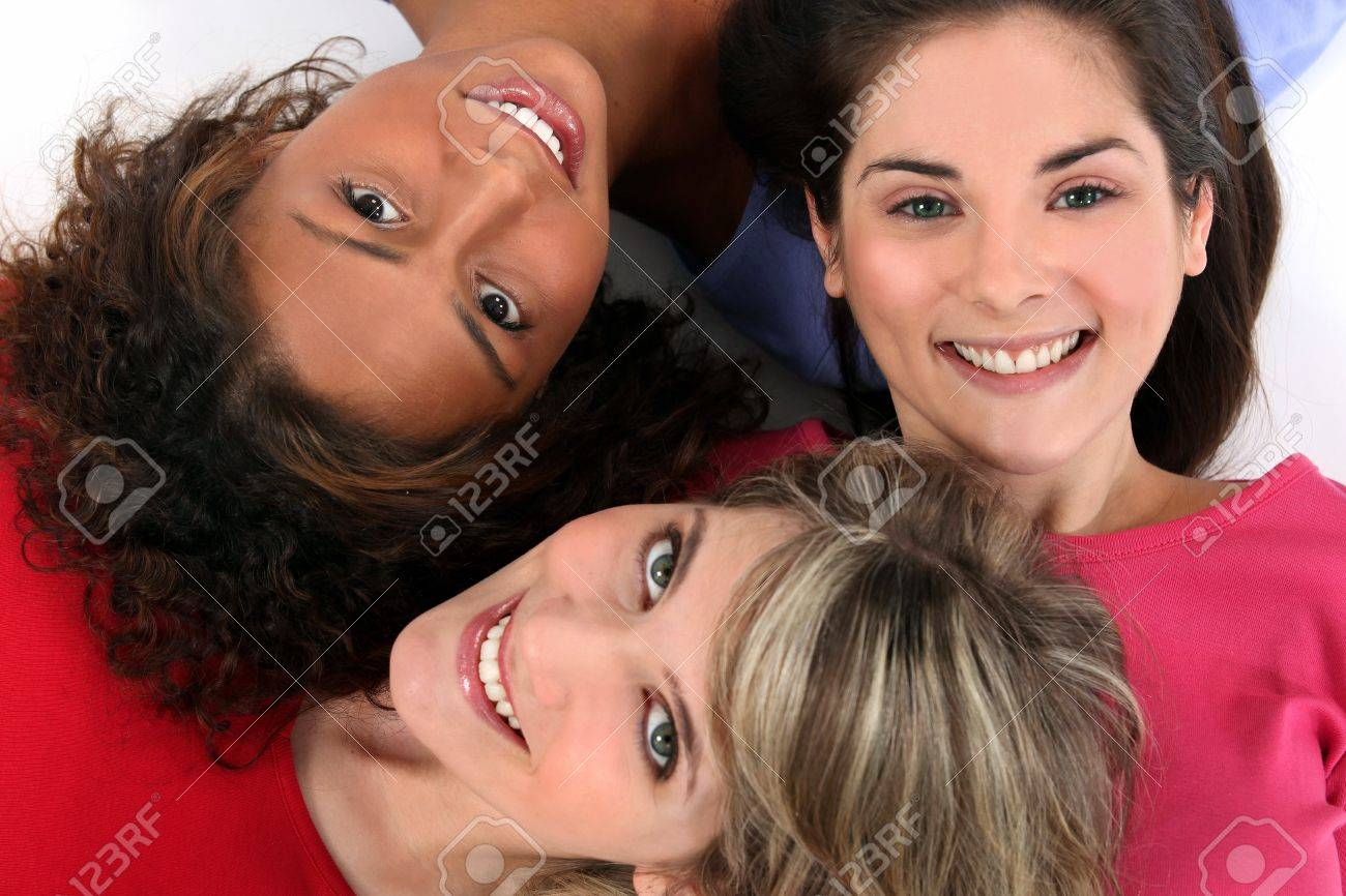 Three female friends laying together Stock Photo - 10855072