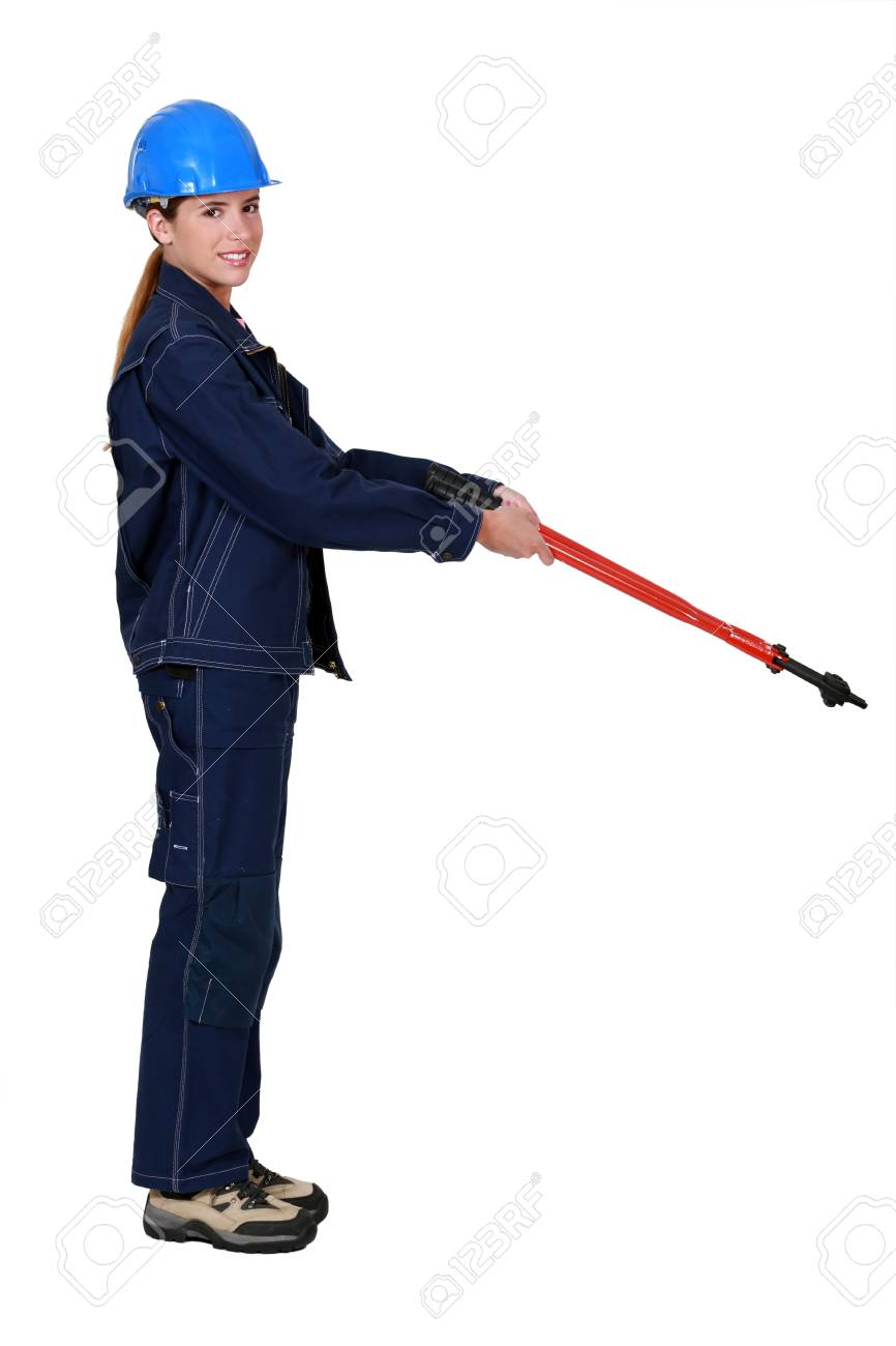 Tradeswoman holding out large clippers Stock Photo - 10851794