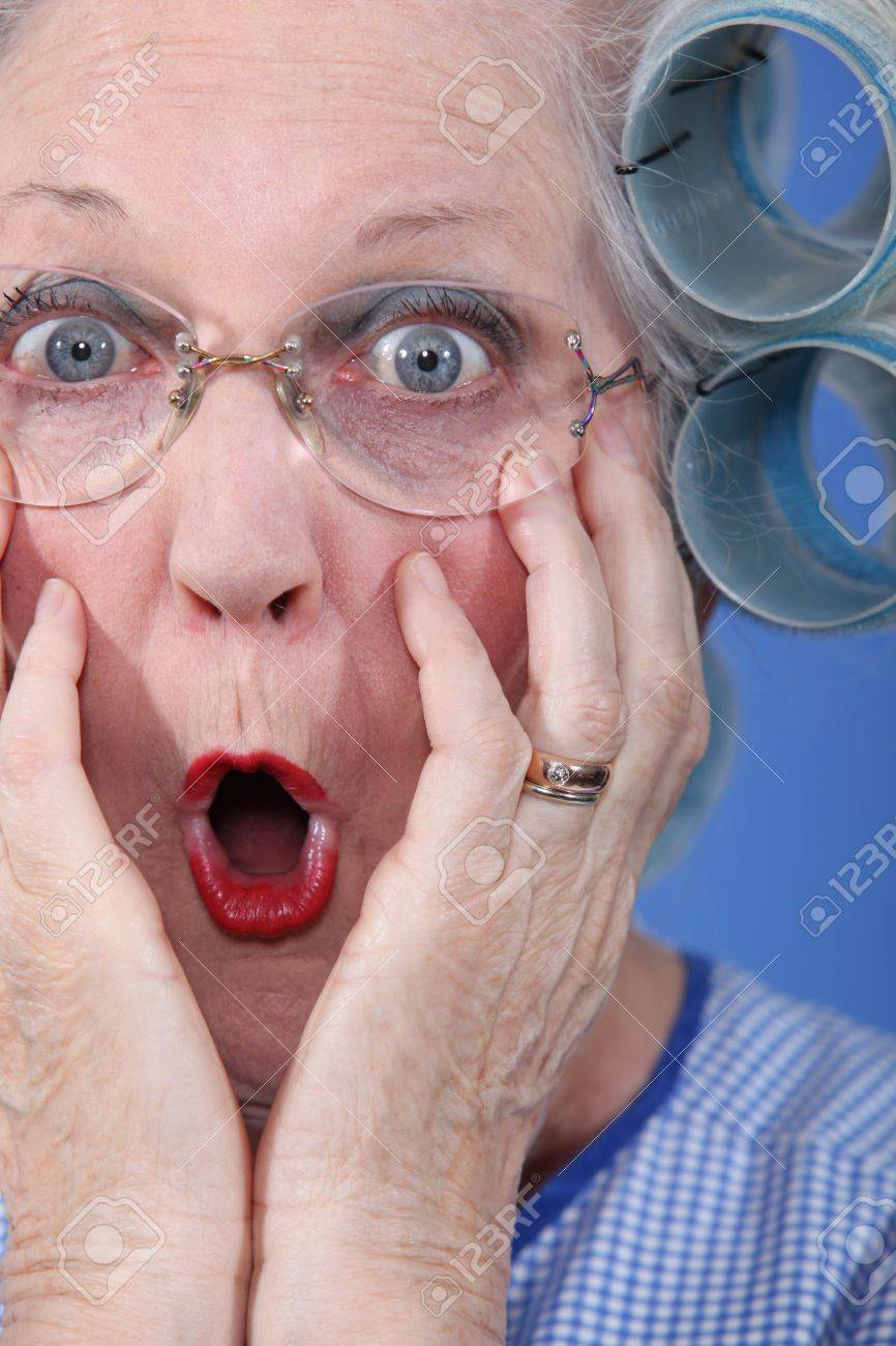 Shocked old lady wearing hair rollers Stock Photo - 10854107