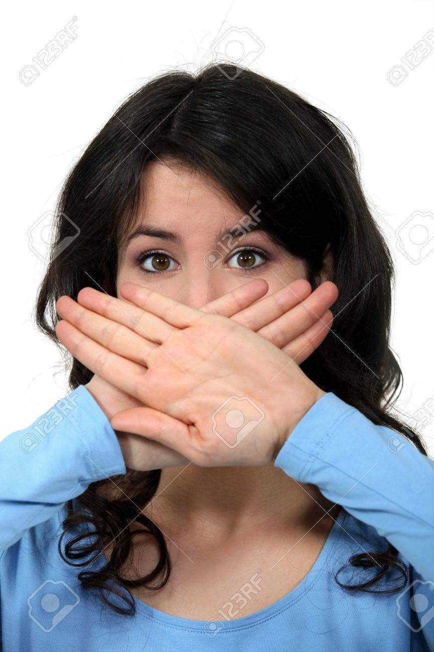 woman covering her mouth with her hands Stock Photo - 10854111