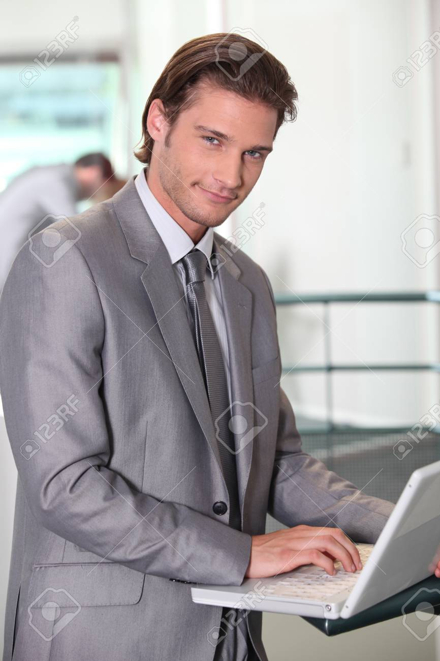 Businessman typing on laptop computer Stock Photo - 10855038