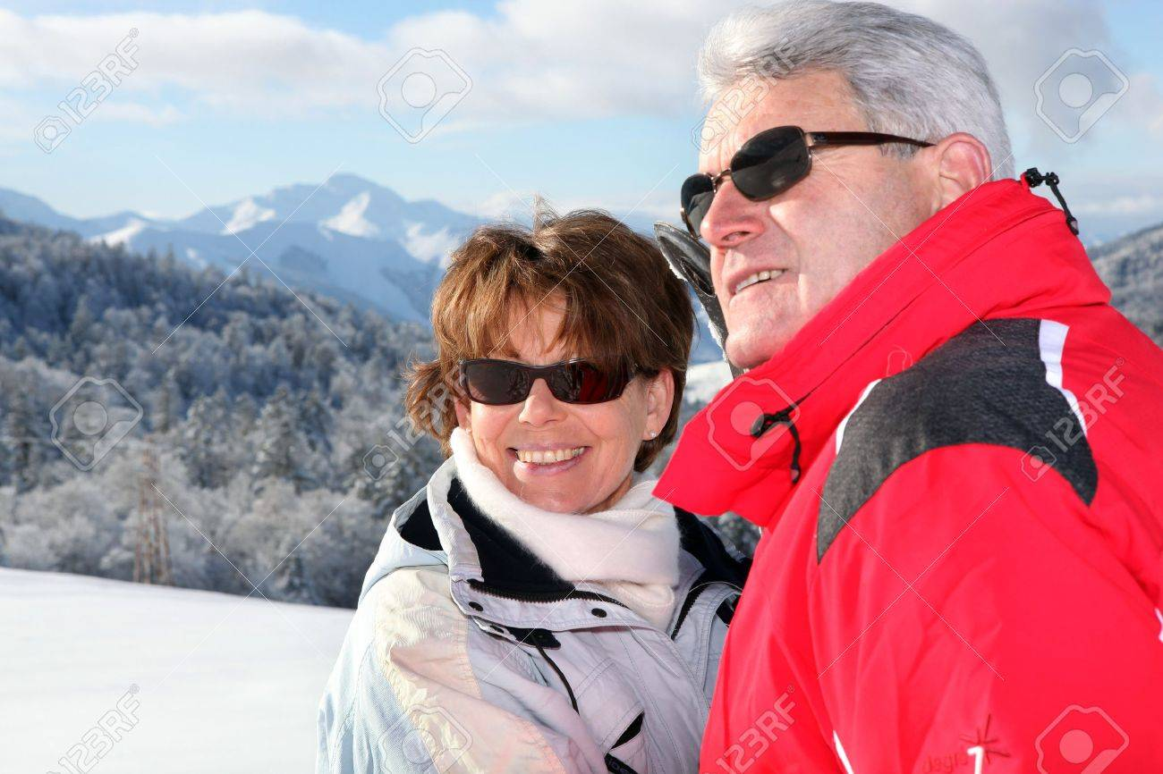 Mature couple on a skiing holiday Stock Photo - 10855135