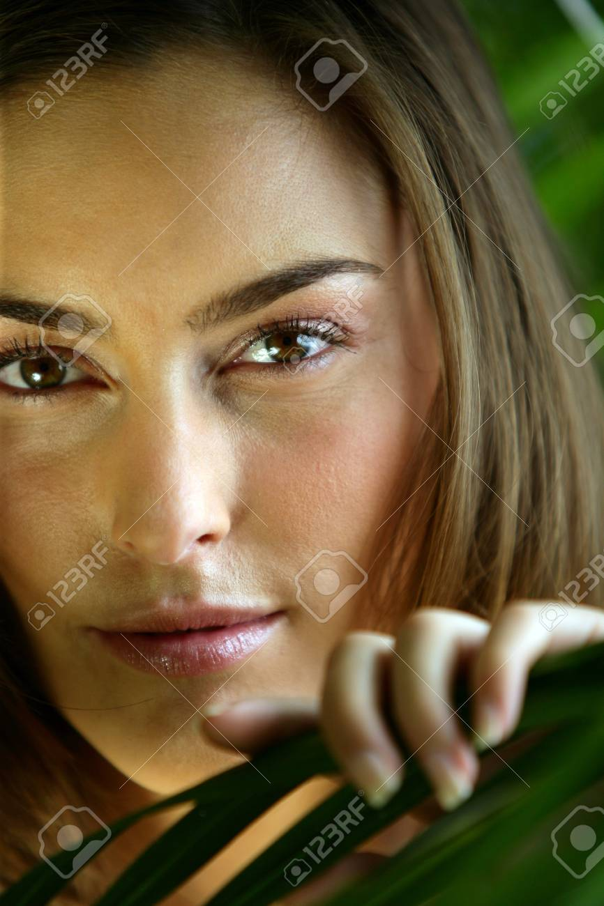 Close-up of woman touching leaf Stock Photo - 10855162