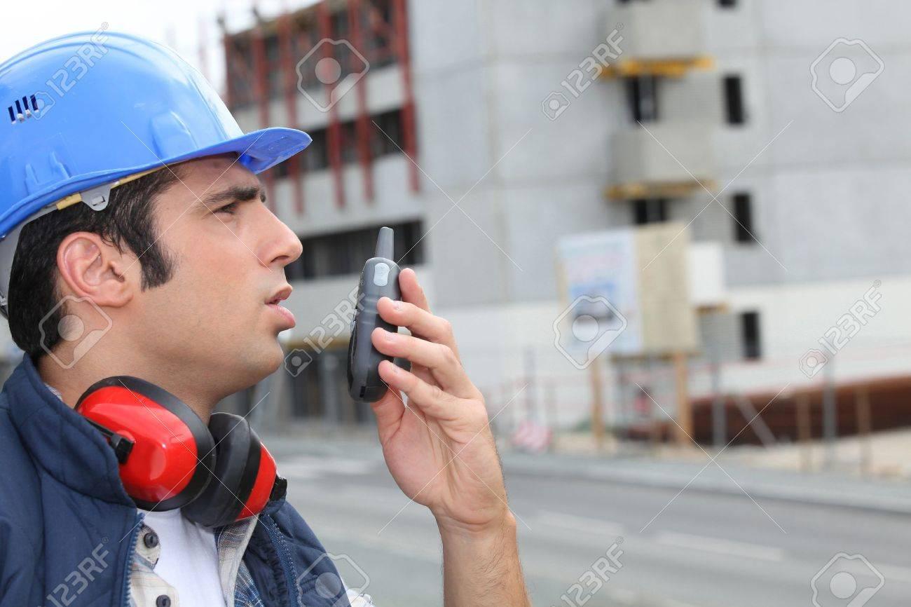 Man speaking into a walkie-talkie Stock Photo - 10855204