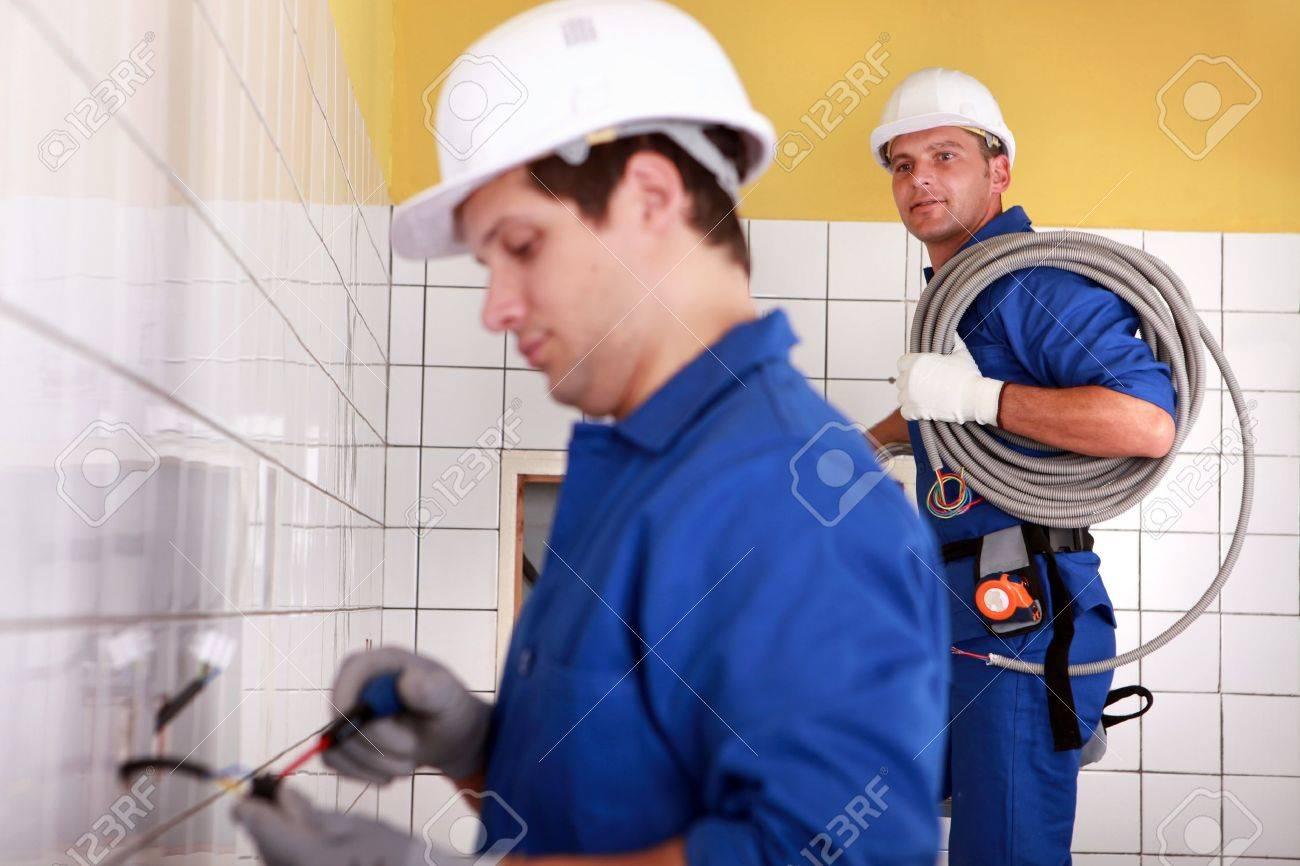 Electricians plumbing a bathroom Stock Photo - 11049541