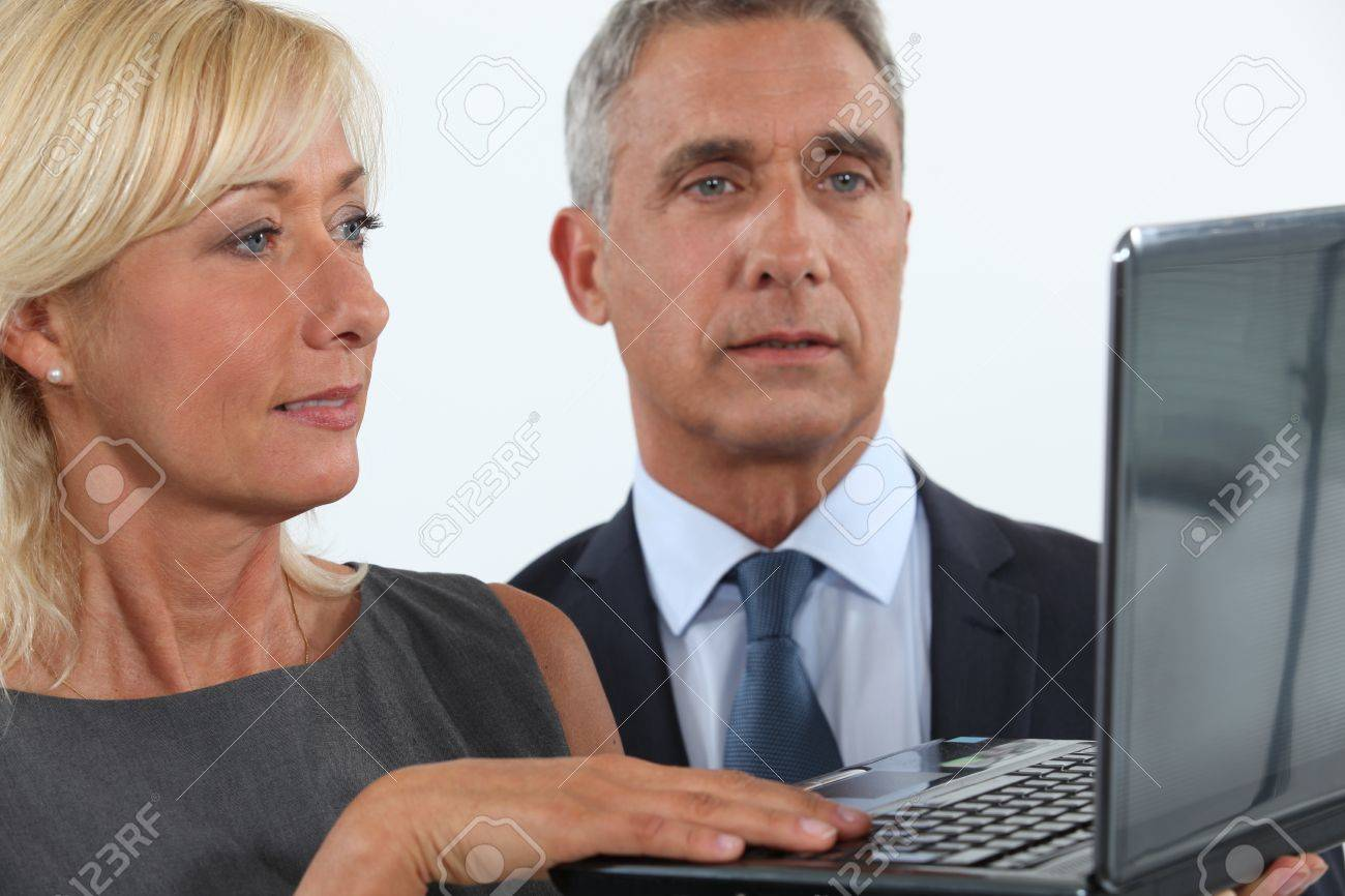 Business professionals looking at a website Stock Photo - 11143720