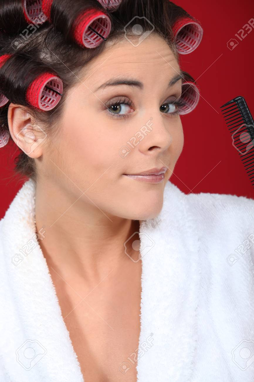 Young woman wearing hair curlers Stock Photo - 11138744