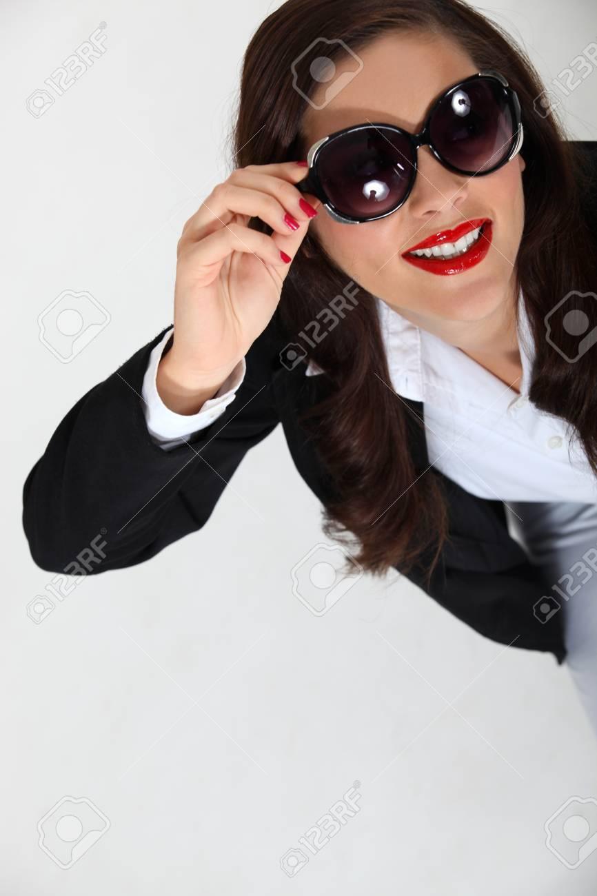 Brunette businesswoman wearing sunglasses Stock Photo - 11050806
