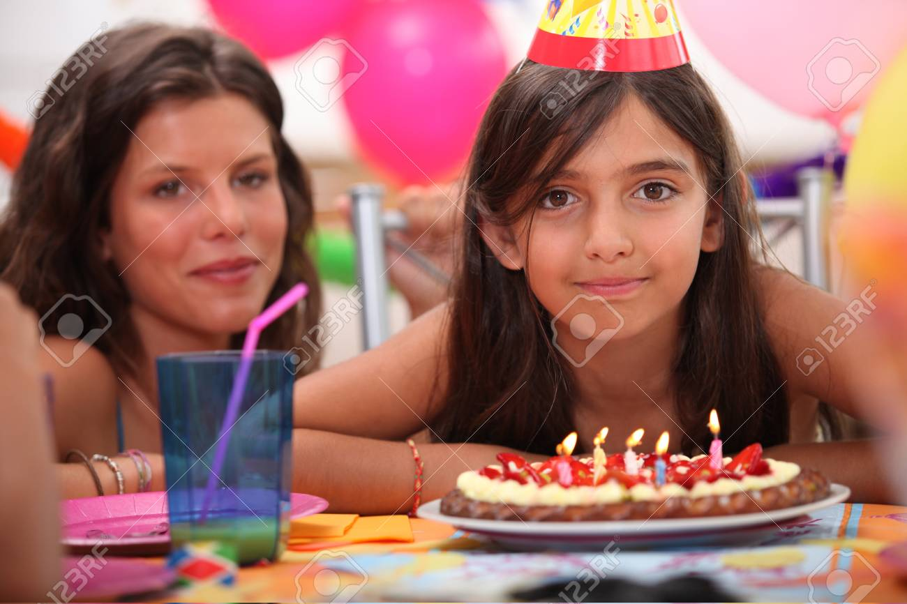 Girl celebrating her fifth birthday Stock Photo - 11039311