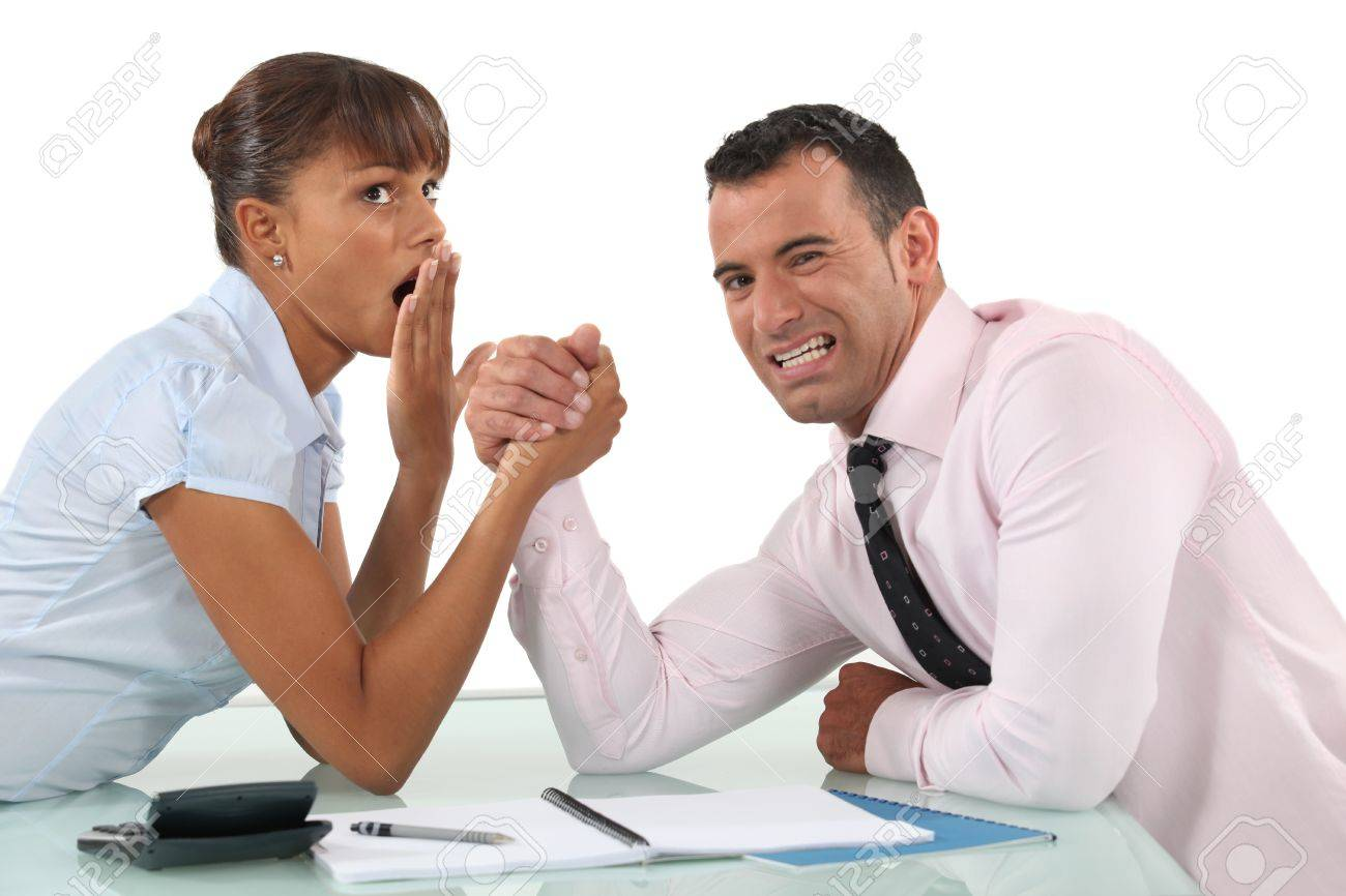 A couple of businesspeople arm wrestling. Stock Photo - 11088094