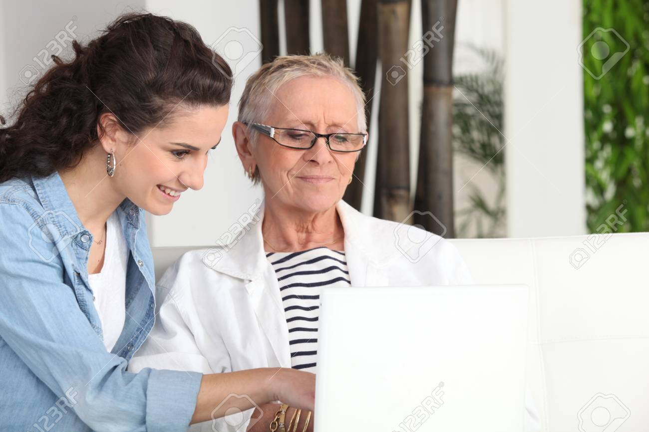 Younger and older woman sitting at a laptop Stock Photo - 11132428