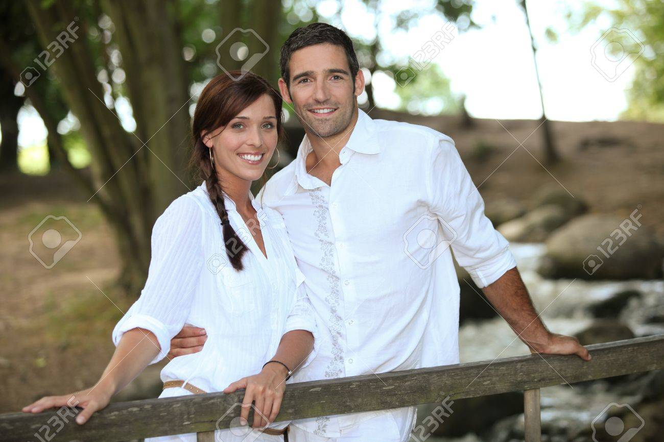 Attractive couple taking a summer stroll through the woods Stock Photo - 11136964