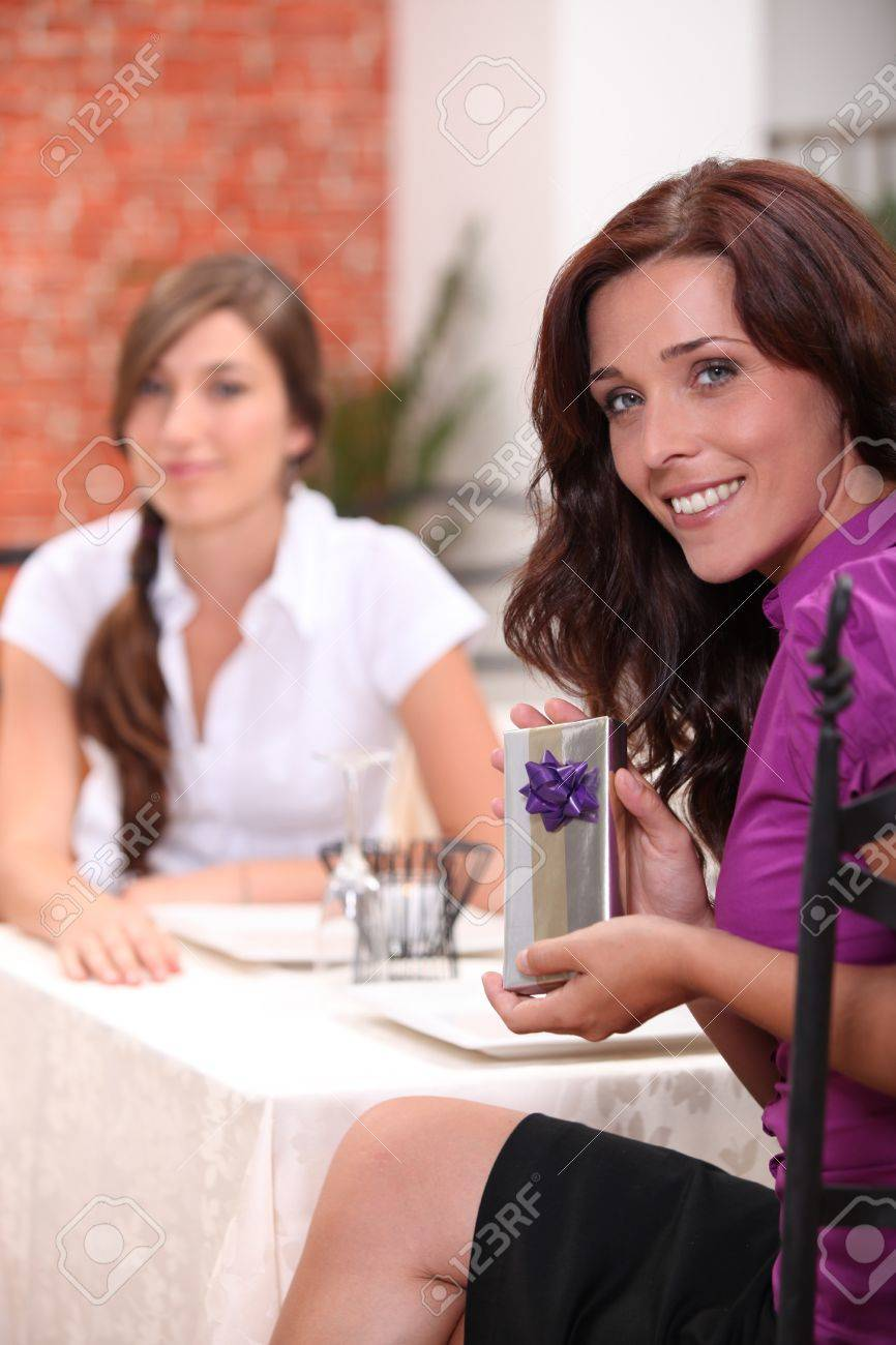 Woman In Restaurant With Birthday Present Stock Photo Picture And