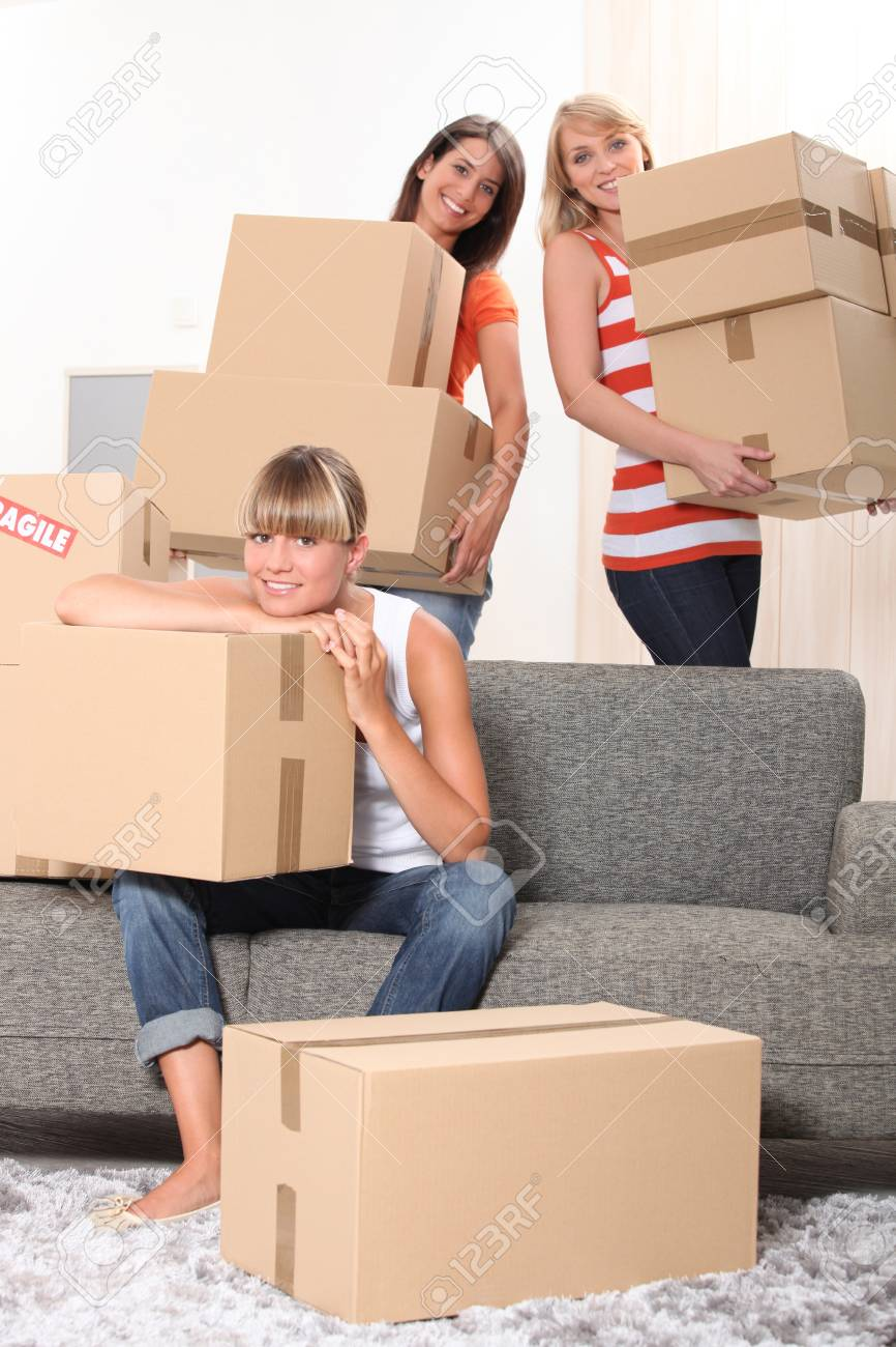 Girls carrying boxes Stock Photo - 11132554