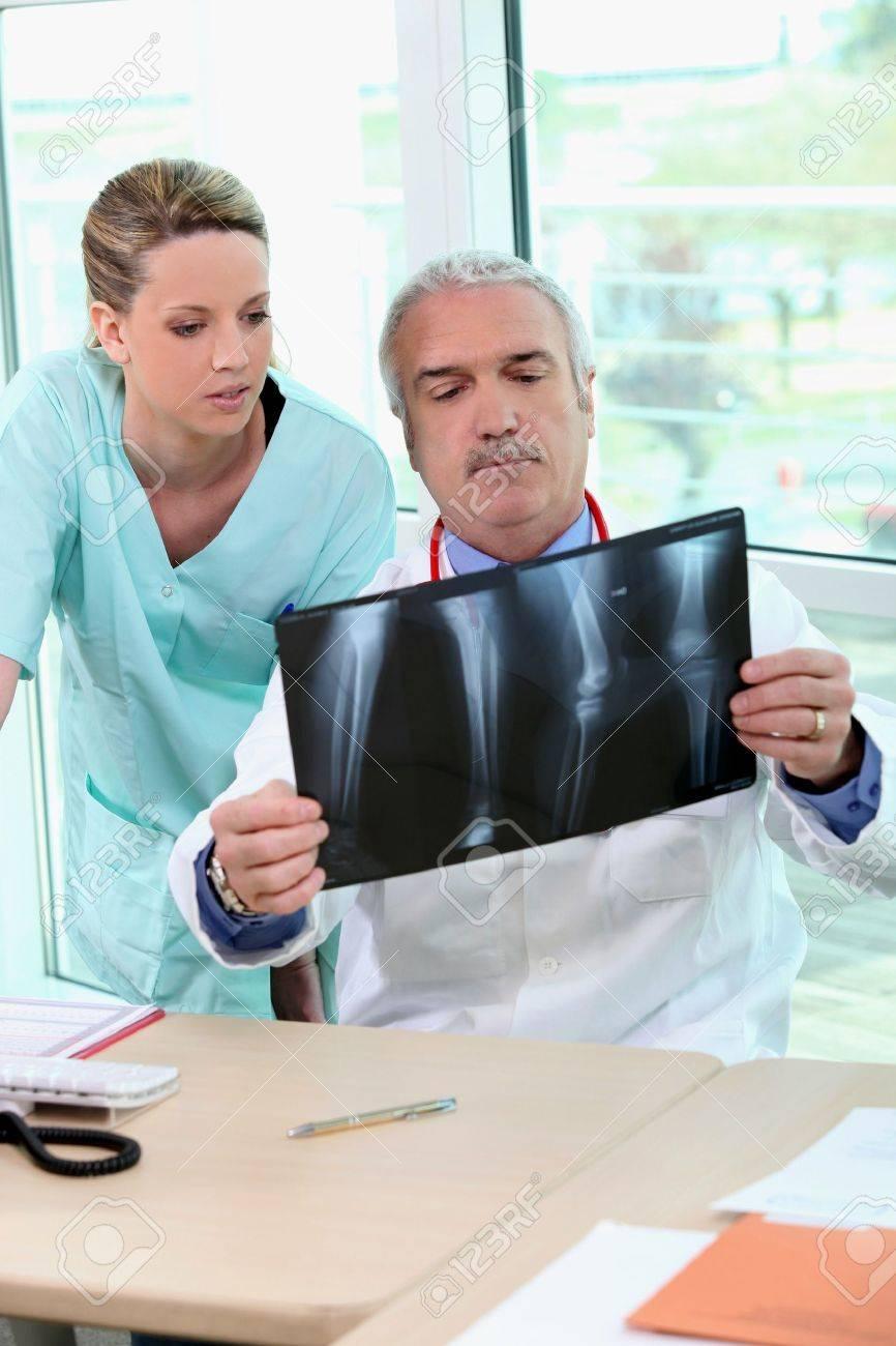 Doctor and nurse examining an xray Stock Photo - 11132265