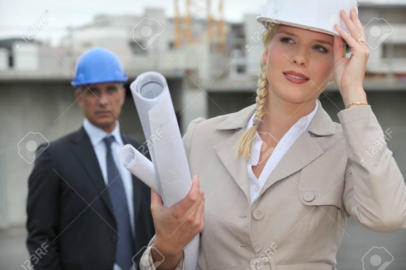 Female architect on site holding her hard hat Stock Photo - 11132340