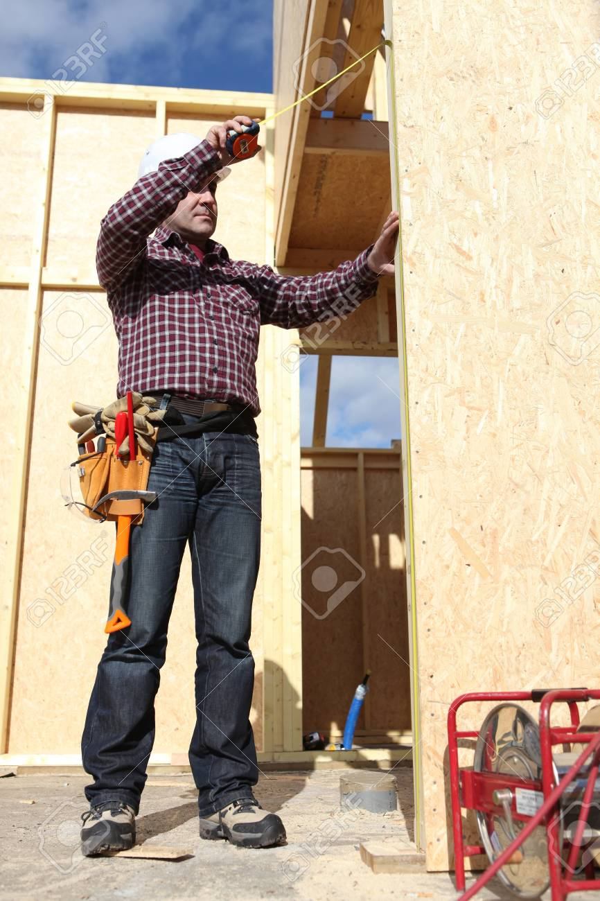 Builder with a tape measure Stock Photo - 11306730