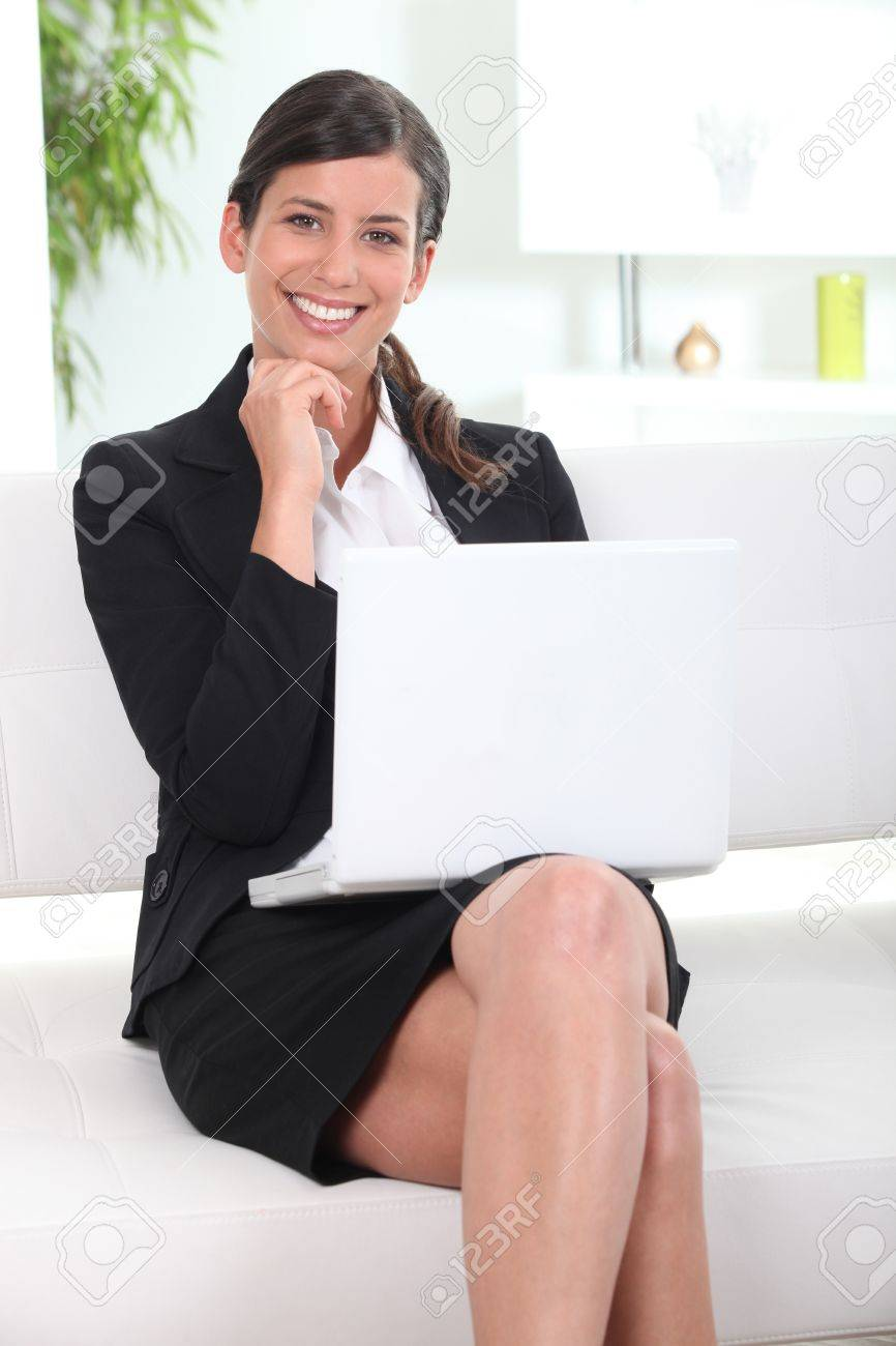 businesswoman working on her laptop in lobby Stock Photo - 11382769