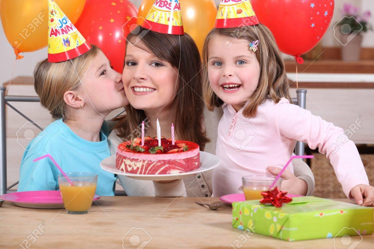 Mum and kids with birthday cake Stock Photo - 11389301