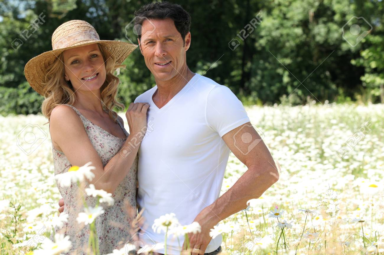 Couple in field of flowers. Stock Photo - 11389575