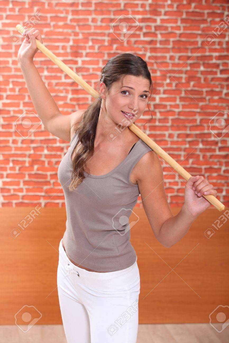 young woman doing fitness with a stick Stock Photo - 11388887