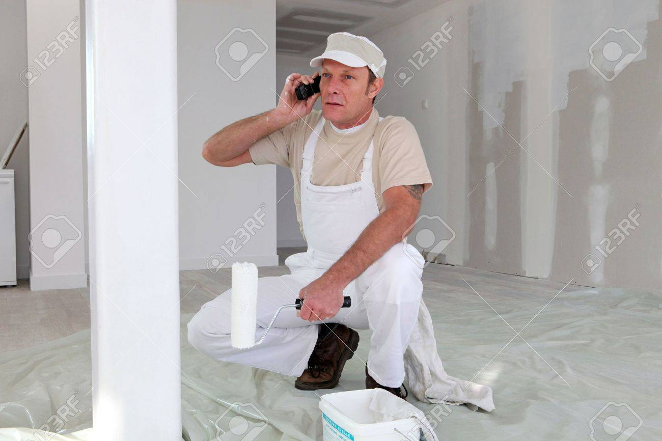 Hard-working painter talking to his client Stock Photo - 11390568
