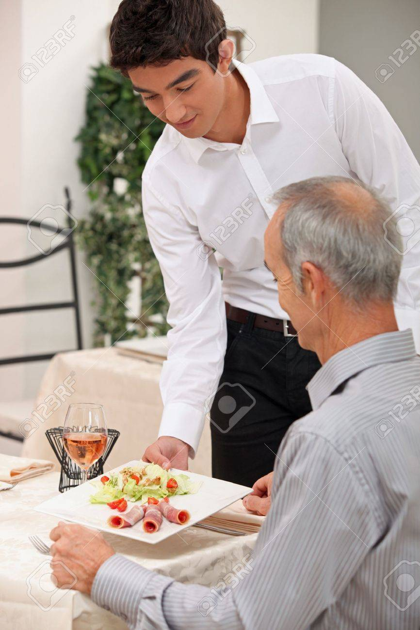 food server stock photos pictures royalty food server food server young waiter serving ham salad