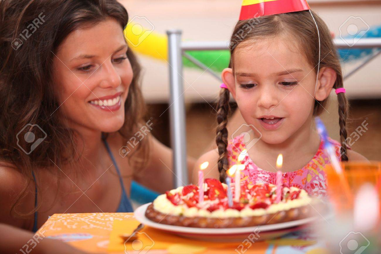 Girl blowing out candles Stock Photo - 11393916