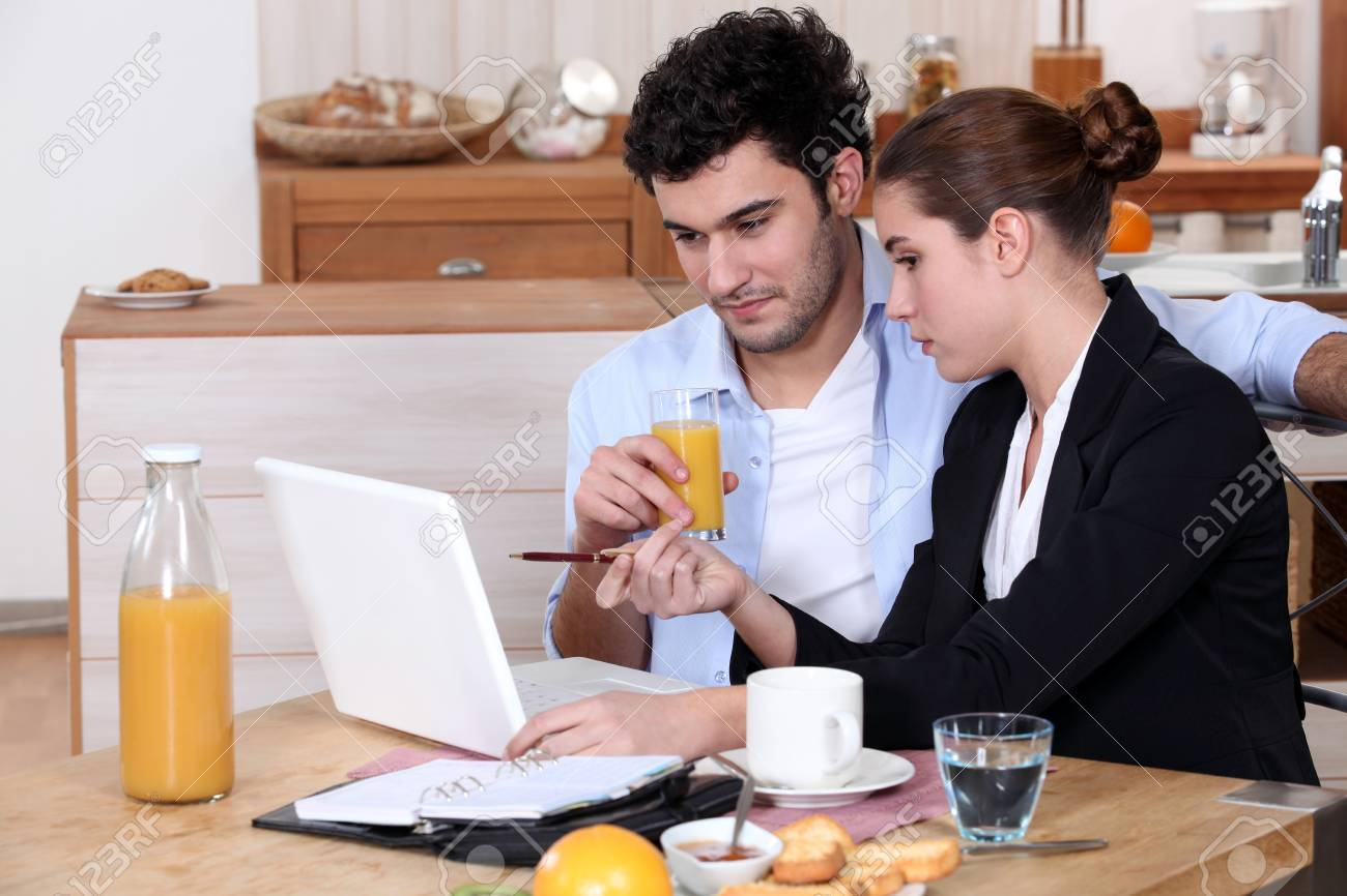 Woman going over a work presentation with her boyfriend during breakfast Stock Photo - 11393845