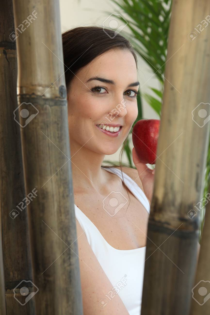 Woman eating a red apple at a spa Stock Photo - 11394029