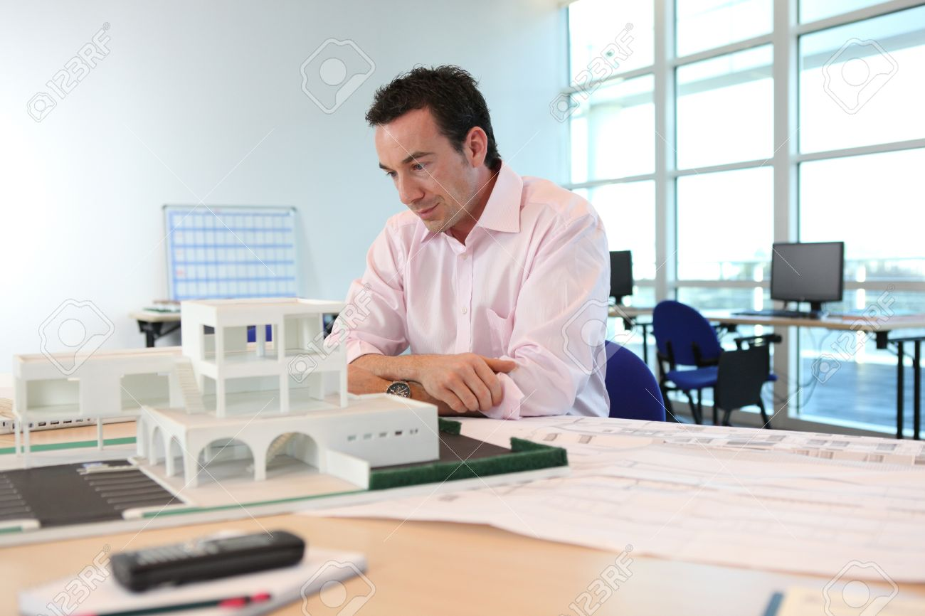 Architect with a model of a building Stock Photo - 11456858