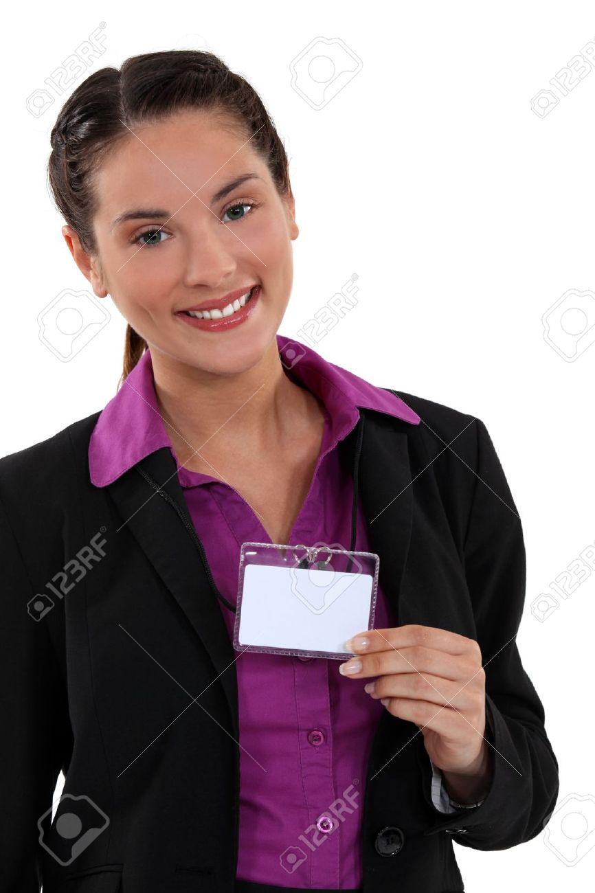 Woman displaying visitor badge Stock Photo - 11457280