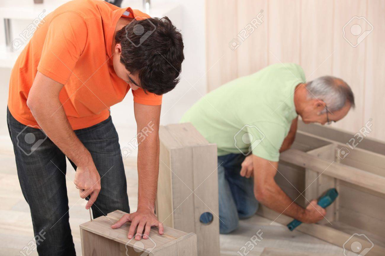 Nice Father And Son Assembling Furniture Stock Photo   11457085