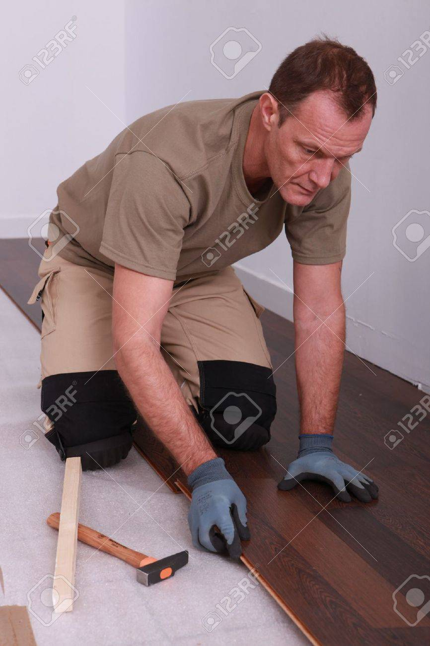 Man laying down flooring Stock Photo - 11456087