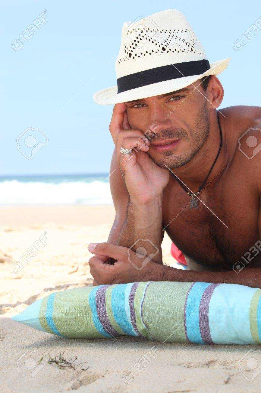 e87400bfc0892b Man On The Beach In A Straw Panama Hat Stock Photo, Picture And ...