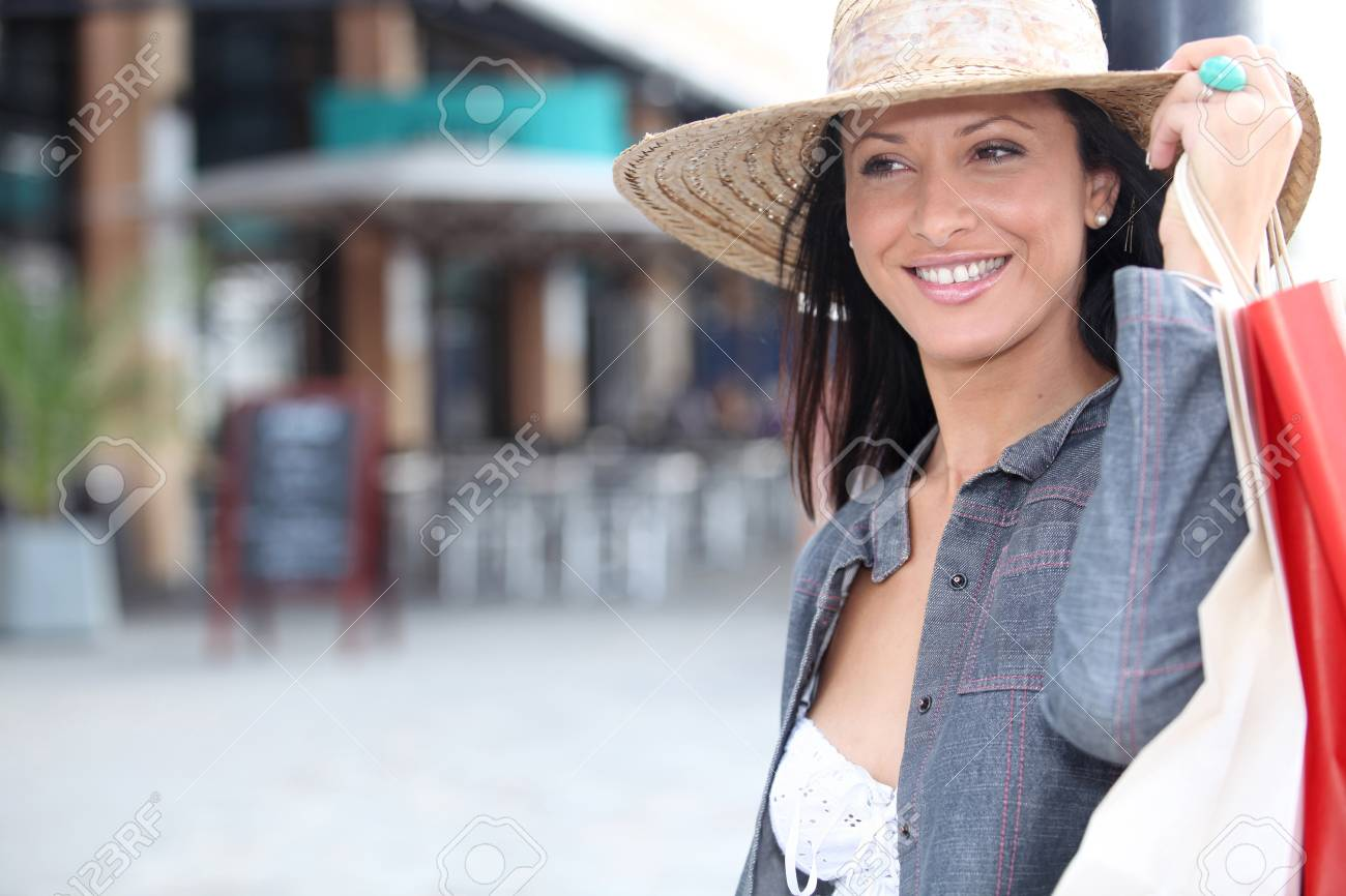 A brunette who went out shopping. Stock Photo - 11603578