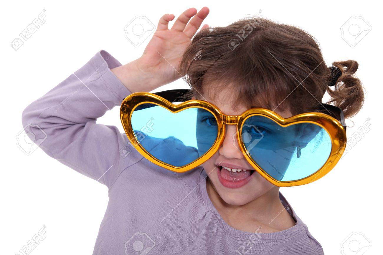 Young girl wearing oversized heart-shaped glasses Stock Photo - 11602923